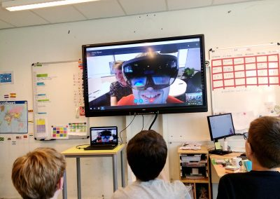 One of our team members presenting VR to young children